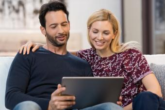 Couple looking at digital tablet