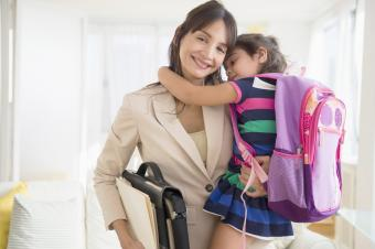 Daughter hugging mother as she leaves for work