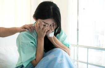 Woman having a miscarriage