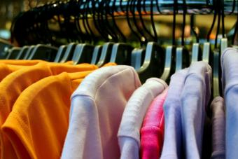 Wholesale maternity tops on a store rack