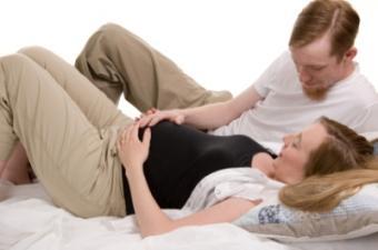 Husband coaching wife in Lamaze breathing