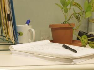 A notepad on an office desk
