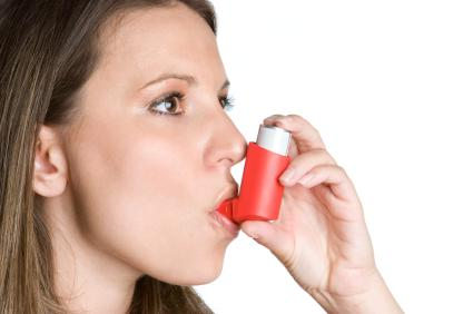 Image of woman using an inhaler during pregnancy