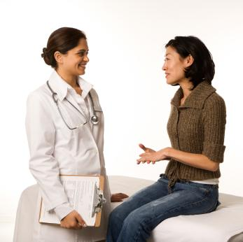 Young woman talking with her doctor
