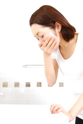 Woman experiencing morning sickness