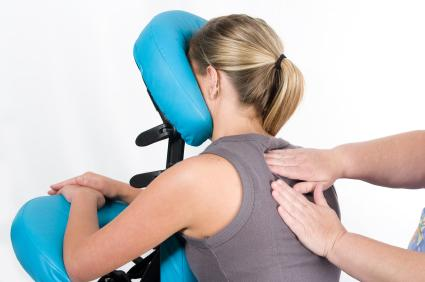 Pregnant woman getting a chair massage