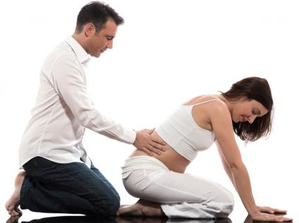 Husband coaching his wife at a prenatal class