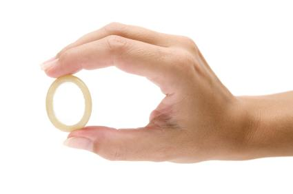 Woman's hand holding a birth control ring