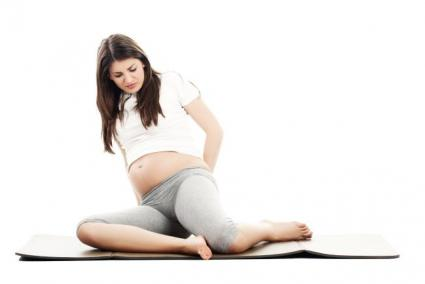 Pregnant woman experiencing hip and back pain