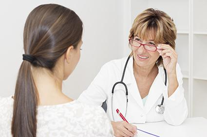 Woman consulting her OB about an IUD