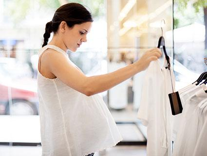 Woman shopping for maternity clothes