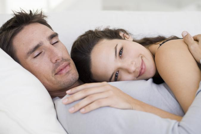 Young couple lying on couch