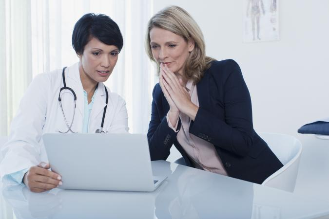 woman with her doctor in office