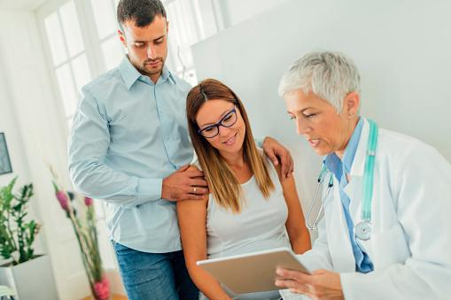 Couple And Doctor In Consultation