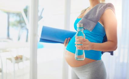 Pregnant woman getting ready to workout at home