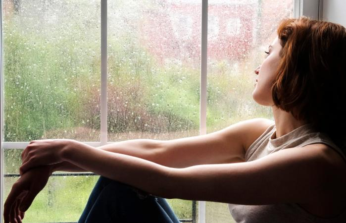 Woman sitting near window