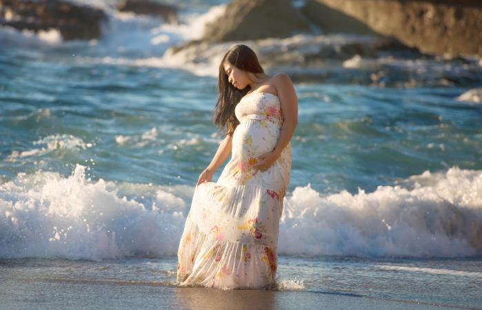 Pregnant woman in a fabulous maxi dress