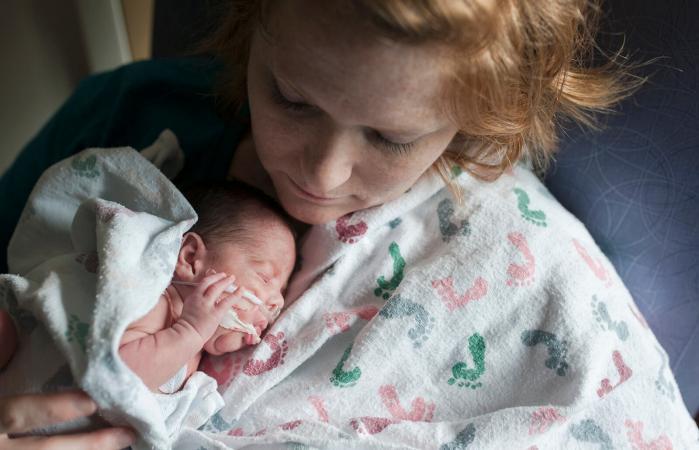 NICU baby is nurtured by mother