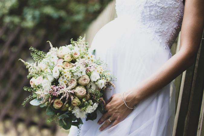 woman in maternity wedding gown