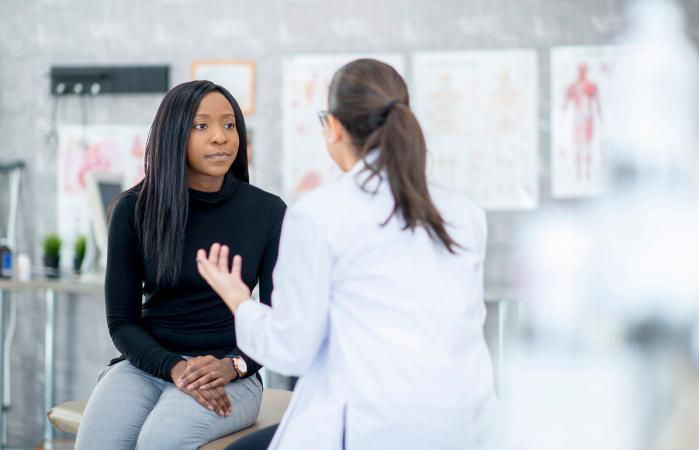 Young woman speaking with a doctor