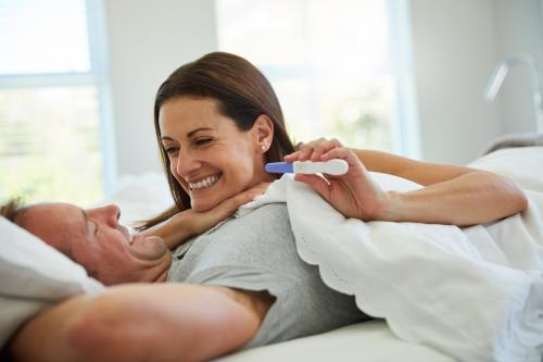 Couple smiling over a pregnancy test