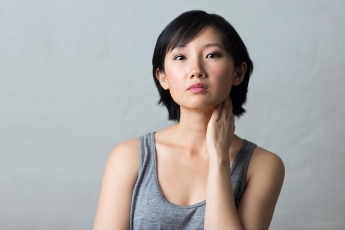 Asian woman looking concerned