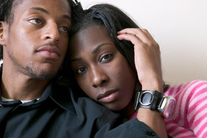 Sad young African American couple