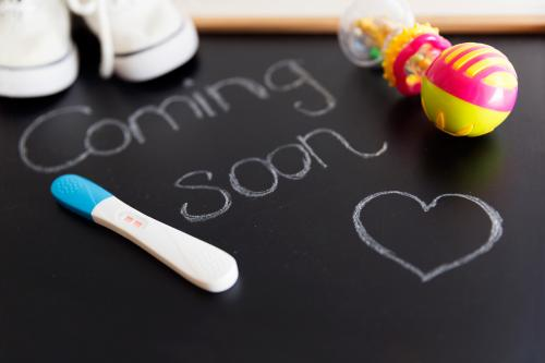 baby coming soon sign on chalkboard