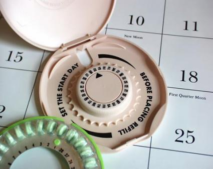 Birth control pills and a calendar