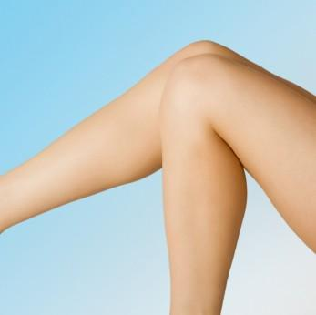Pair of legs against blue background