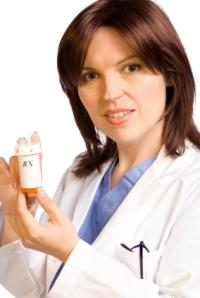 Pharmacist holding a bottle of Lexapro