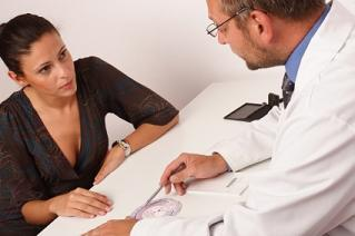 Infertility patient talking to her doctor