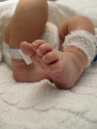 Image focused on newborn baby feet