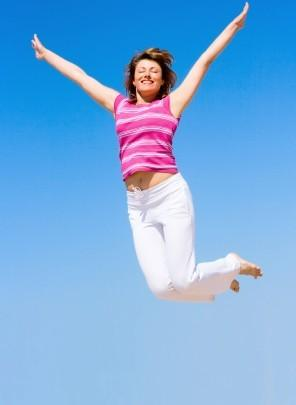 Image of a woman jumping for joy
