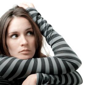 Woman pondering ovulation and menstruation