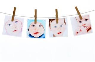 Photos of quadruplets hung on a line