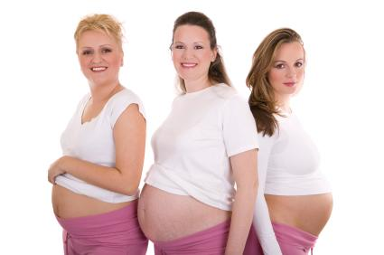 Three pregnant women.