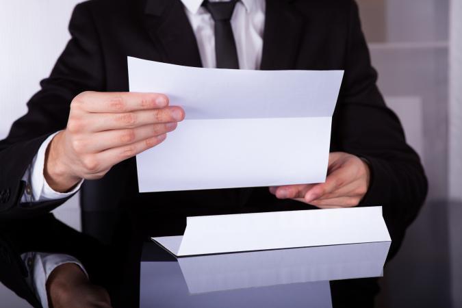 Businessman Holding Letter