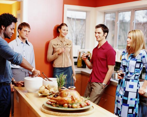 Group of young adults in kitchen
