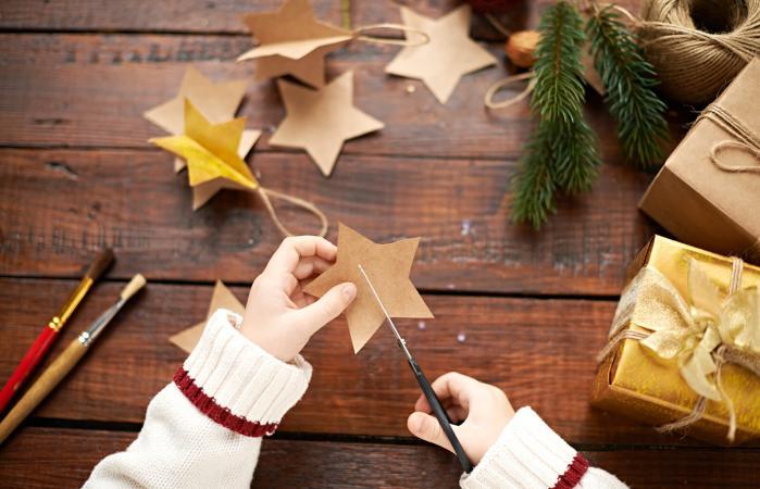 Little boy making Christmas decoration