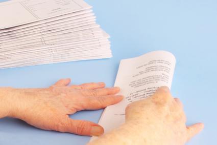 Mature Woman's Hands Folding Newsletters