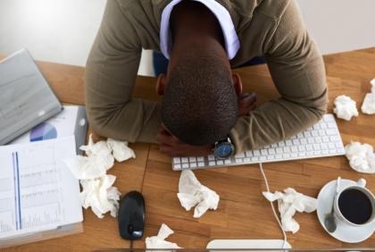 Man with symptoms lying on keyboard