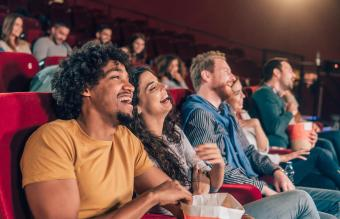 Friends laughing at cinema
