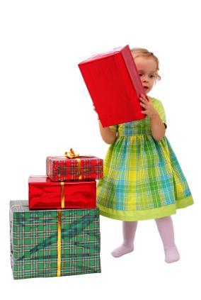 A toddler checks holiday gifts.