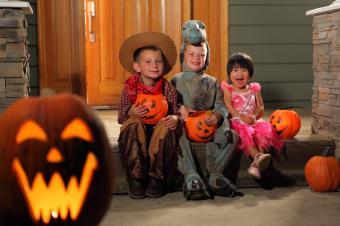 Children in costumes on Halloween night