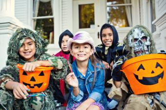 Little trick-or-treaters on a porch