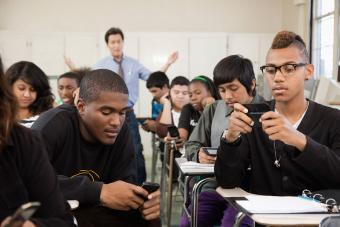 Frustrated teacher with students in classroom