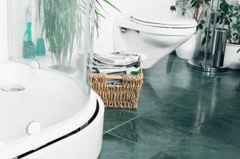 Stack of paper next to toilet
