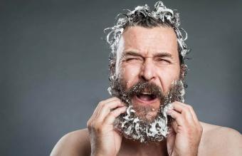 Man washing his beard