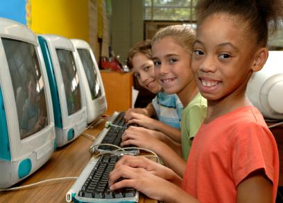 Children using computers at school.